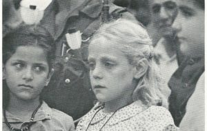 BLOND PALESTINIAN (above) is 10-year-old Lara al-Ghoush. The photograph was taken at the 1981 funeral of her parents, who had just been murdered by Lebanese Christians working for the Israelis. The Palestinians, like the Jews, are a racially mixed people, but there are still a number of unmixed Whites among them. After the initial Philistine settlement, there were several further infusions of European blood: from the Romans, who established a colony in Jerusalem in the first century, after expelling the Jews; from the German Crusaders, who founded several kingdoms in Palestine during the Middle Ages; and from later European settlers, who continued to colonize the area as late as the last century, primarily for Christian reasons.