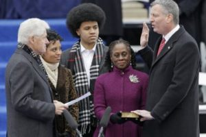 What a farce: Bill Clinton administers a meaningless oath of office to de Blasio.