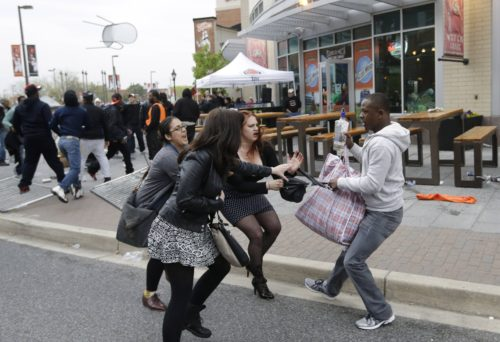 Is this a White woman stealing a purse from a noble Black non-violent protester?