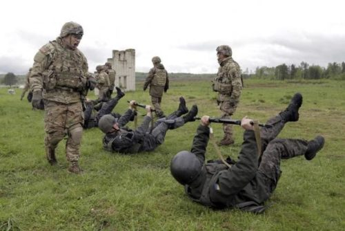 Servicemen of the U.S. Army's 173rd Airborne Brigade Combat Team train members of the Ukrainian National Guard during a joint military exercise near Starychy