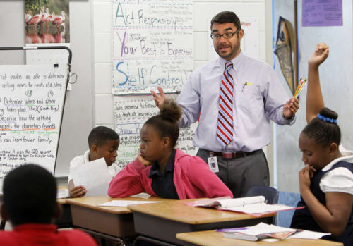 Principal Robert Ovalle talks with fourth-graders at Campbell Park.