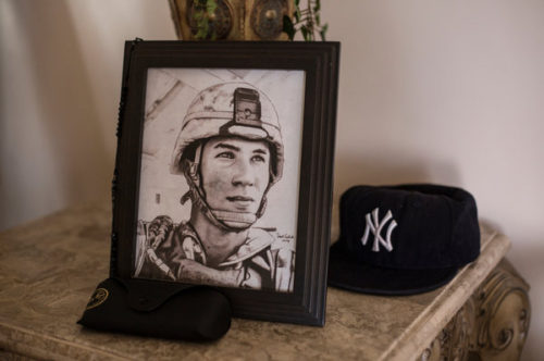 "A portrait of Lance Cpl. Gregory Buckley Jr. in his family's home in Oceanside, N.Y. He was shot to death in 2012 by a teenage ""tea boy"" living on his base in Helmand Province."