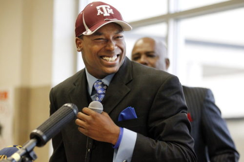 """Mr. Johnson"": Skyline High wide receiver Thomas Johnson flashes a big smile, after he signed his National Letter of Intent to play college football for Texas A&M University in 2012"