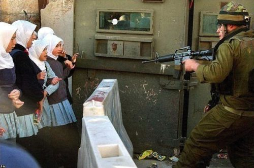 jewish_soldier_pointing_gun_at_schoolgirls_f