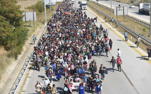 Migrants walking towards Greece border along a highway on their way to the border between Turkey and Greece
