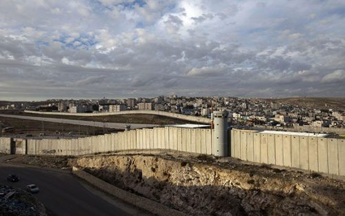 A general view shows a section of Israel's controversial separation barrier in the West Bank village of Al-Ram on the outskirts of Jerusalem on December 7, 2012. AFP PHOTO/AHMAD GHARABLI (Photo credit should read AHMAD GHARABLI/AFP/Getty Images)
