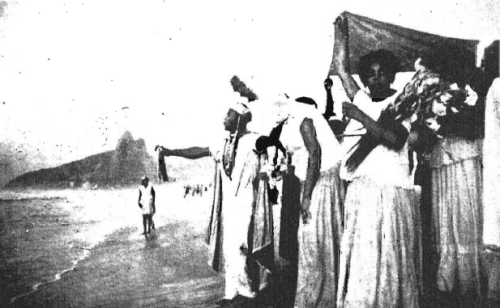 Mulatto Catholics in Rio de Janeiro celebrate the rite of an African spirit cult on the beach. They are offering a sacrifice to Iemanja, a sea witch. The Roman Catholic Church increasingly tolerates irregularities of this sort as the non-White membership of the Church grows. In some parts of Latin America Christian doctrine is so strongly modified by local paganism as to be barely recognizable.