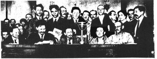 "The grave diggers of Russia were overwhelmingly Jewish. This 1917 photograph of a meeting of communist leaders in Petrograd (previously St. Petersburg, now Leningrad) is typical, with four of the five top communists seated at the table known to be Jews. They are, from left to right: Moses Uritsky, Petrograd Cheka boss; Lev Trotsky (Bronstein), later Red Army commissar; Yakov Sverdlov, second president of the ""Soviet Republic""; and Grigori Zinoviev (Apfelbaum), president of the Petrograd Soviet. The ethnic affiliation of the fifth man at the table is unknown."