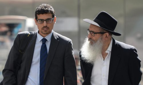 Manny Waks and his father Zephaniah leave the county court in Melbourne.