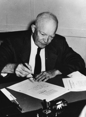 "Eisenhower signs the ""Civil Rights Act of 1957,"" which began the racial destruction of the United States, and which enabled him to ""integrate"" American schools at gunpoint later that year."