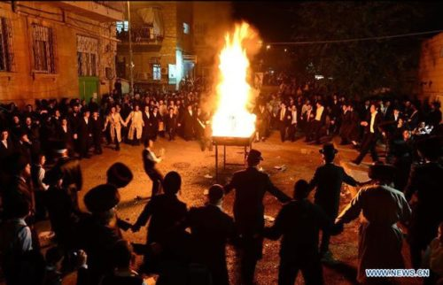Jerusalem, April 27, 2013: Ultra-Orthodox Jews dance around a bonfire on Lag BaOmer, a Jewish holiday that has been reinterpreted in modern times as a commemoration of the Bar Kokhba revolt.