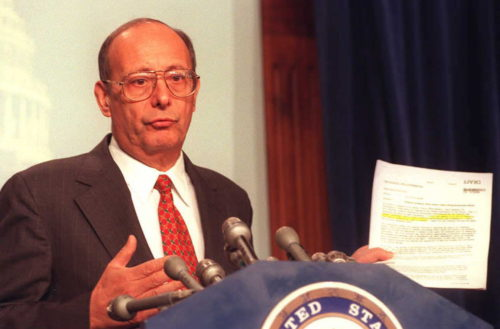 WASHINGTON, DC - JANUARY 5:  US Senator Alfonse D'Amato, R-NY, chairman of the Senate committee investigating Whitewater, holds a copy of a memo turned over to the committee by the White House as he speaks to reporters during a press conference on Capitol Hill in Washington, DC, 05 January. The memo written by White House aide David Watkins contradicts US First Lady Hillary Clinton's contention that she played no role in the firings of the White House travel office employees.  (Photo credit should read PAM PRICE/AFP/Getty Images)