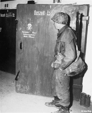"Dachau ""gas chamber"" door. This official US Army photo was taken at Dachau on April 30, 1945, one day after the camp's liberation. It shows a GI standing in front of a door marked with a skull and crossbones. According to the official caption, ""these chambers were used by the Nazi guards for killing prisoners of the infamous Dachau concentration camp."" In fact, this is a small disinfection gas chamber used for delousing clothes, as part of the routine to curtail the spread of disease. This chamber was never used to kill people. For several decades, this photo has been widely reproduced to help keep alive the notorious Dachau ""gas chamber"" myth. A large blow-up of this photograph was on display at the Weber-Shermer debate."