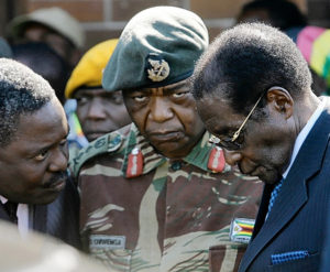Zimbabwe's Robert Mugabe, right, in conference with fellow statesmen