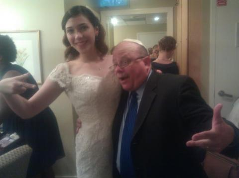 "Rabbi Lebow in one of his typical ""touchy-feely"" pictures taken with a Jewish bride whose wedding he officiated."