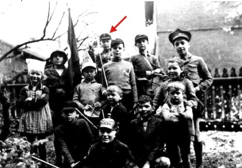 Our service in the Hitler Youth did not take all of our time, as seen from this picture of 1938. We had invited playmates form the neighborhood to play soldiers. Note the real weapons from our attic. Two guns were old flintlock rifles. One of the swords was a beautiful, hand engraved antique. All these weapons probably ended up as war booty in America. The headgear was from prior wars. Of the five boys at the top, Kurt Seiler, myself [arrowed], RolfBorschel and Erich Seiler served in the Waffen-SS. Kurt died in Hungary, Erich rose after the war to a high police rank, Rolf was unlucky enough to get caught in the French dragnet of 1947 (which I escaped) and ended up a slave worker in Lille.
