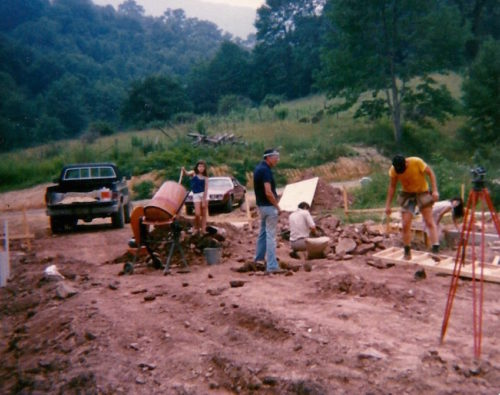 William Pierce, National Alliance members, and their families help lay the foundation for the main building on The Land in 1985