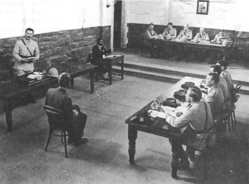 "Courtroom scene from the 1980 Australian film ""Breaker Morant,"" which highlighted the British policy of shooting Boer prisoners during the war in South Africa. The film dramatized the case of several Australians serving with the Bush Veldt Carbineers, a special ""anti-commando"" unit, who were tried and executed in February 1902 for having shot twelve Boer prisoners. In the award-winning film, Edward Woodward played the role of Lt. ""Breaker"" Morant."
